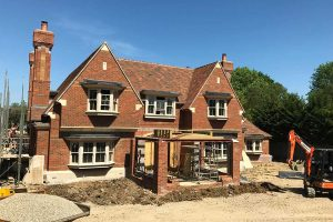 Arts and Crafts Family Home Surrey, South elevation in decorative brickwork and stone