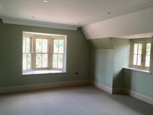Arts and Crafts Family Home Surrey, bedroom painted in Morris inspired muted colours